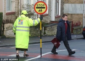 Lollipop lady or is it a school crossing patroller?